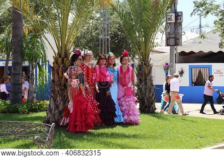 Cordoba, Spain - May 23, 2017: Unidentified Women In Colorful National Dresses Are The Feria Festiva