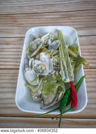 Simple Dish Of Asian Saltwater Clam With Chilli, Lemongrass And Garlic In Clear Broth. Selective Foc