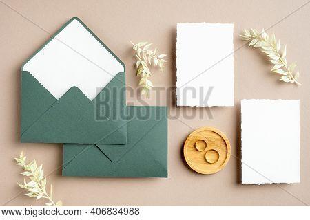 Feminine Wedding Stationery Set. Blank Greeting Card, Green Envelopes, Dried Flowers, Golden Rings O
