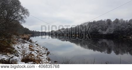 Winter River Landscape. The Natural Background. Winter Holiday Background. The Shore Is Reflected In