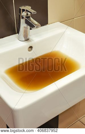 Dirty Clogged Sink With Dirty Water In A Restaurant. Blockage Problems In The Bathroom And Toilet
