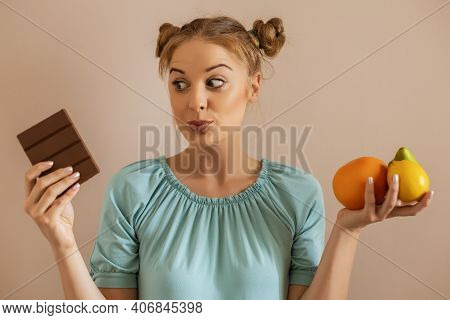 Cute Woman Having Doubts With Healthy And Unhealthy Eating.toned Image.