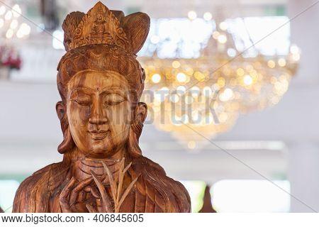 Beautiful Wood Statue Of Guan Yin At Huay Pla Kang Temple, Chiang Rai, Thailand.