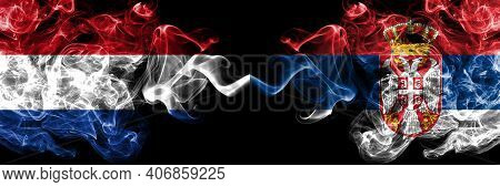 Netherlands Vs Serbia, Serbian Smoky Mystic Flags Placed Side By Side. Thick Colored Silky Abstract