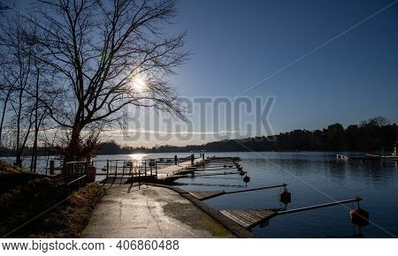 Empty Docks In The Port Of Scharmuetzelsee, Brandenburg, Germany. Reflection In The Water. Empty Doc