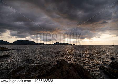 Dark Storm Cloud Rain Clouds Over Sea In Sunset Or Sunrise Sky Dramatic Black Cloudscape In Bad Weat