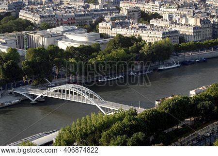 A Beautiful Aerial Panoramic View Over Paris, The Seine River, The Passerelle Debilly Pedestrian Foo