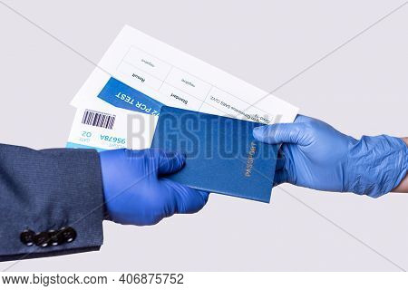 Gloved Hands Holding Out Documents For Air Travel To The Officer To Check. Passport, Ticket, Covid-1