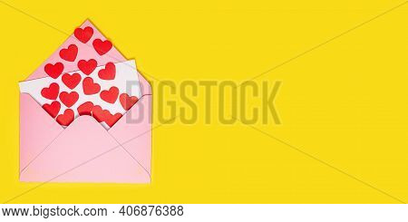 Valentines Day Card. Paper Hearts Fly Out Of Pink Paper Envelope On Yellow Background. Paper Art On