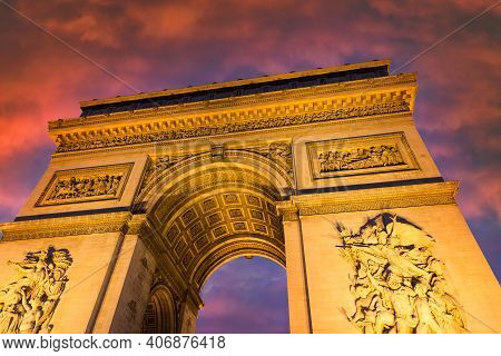 Spectacular Sunset View Wirh Colorful Clouds Of Illuminated Arc De Triomphe In Paris, France