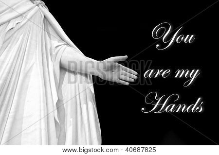 Statute of Hand of Jesus with black background with saying you are my hands