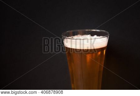 Beer Glass On Dark Background. Selective Focus. View With Copy Space.