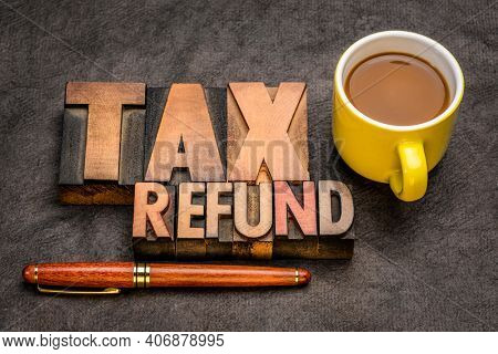 tax refund  banner - word abstract in vintage letterpress printing blocks against textured paper with a cup of coffee, business financial concept
