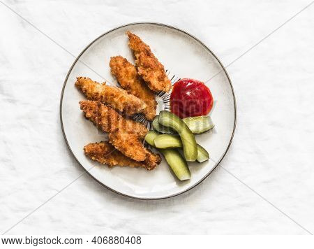 Chicken Fingers, Cornichons And Ketchup - Delicious Tapas, Appetizers, Snack On The Light Background