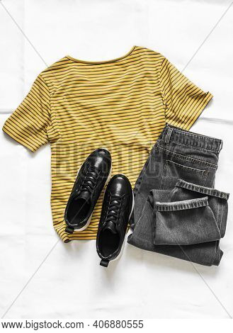Women's Clothing - Yellow Cotton Striped T-shirt, Gray Mom Jeans And Black Leather Sneakers On A Lig