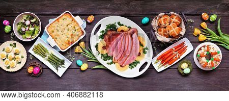 Classic Easter Ham Dinner. Top View Table Scene On A Dark Wood Banner Background. Ham, Scalloped Pot