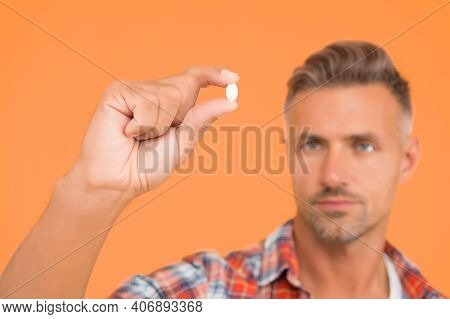 Vitamin Pill In Hand. Side Effects. Medicines Concept. Hemp Derived Cbd. Food Additives Vitamins For