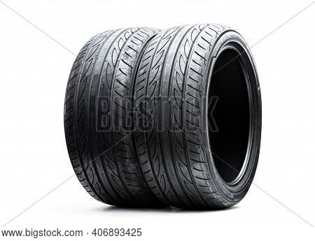 A Pair  Of Brand New Asymmetric Type Sport Tyres Isolated On White