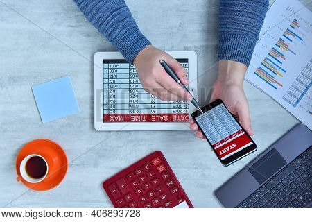 Businessman Doing Business And Charts Being Demonstrated On Screen Of A Mobile Phone. Success And St