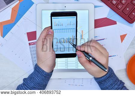 Businessman Hands Working With Documents On Smart Phone Screen. Finance And Trade Concept. Close Up