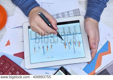Businessman Work With Documents On Tablet Computer Screen. Finance And Trade Concept. Close Up