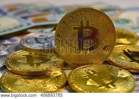 Close Up Of Golden Bitcoin Money And Dollar Bills. Cryptocurrency And Payment Concept.