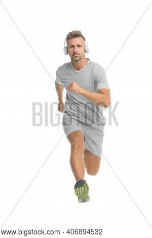 Motivational Song. Man Sportsman Running With Headphones. Runner Handsome Strong Guy In Motion Isola