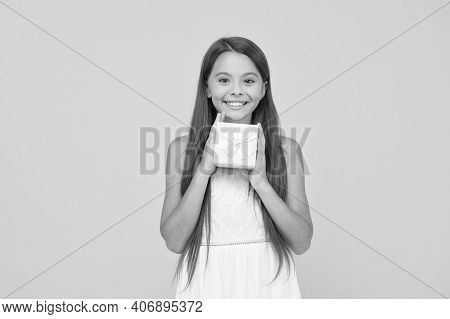 Online Shop. Boxing Day Concept. Small Child On Yellow Background. Holiday Shopping Sales. Beauty Bo
