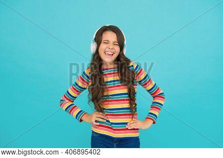 Energetic Rhythm Concept. Good Track Improves Mood. Happy Small Girl Listen Music. Little Child Enjo