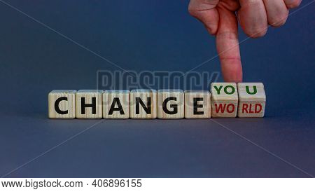 Change World Or You Symbol. Businessman Turns Wooden Cubes And Changes Words 'change World' To 'chan