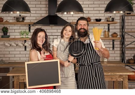 Little Girl With Parents Cooking. Family Tradition. Happy Family In Kitchen. Pleasant Time Together.