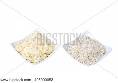 Whole Grains Of Rice And Flattened Rice Flakes In Bowls, Isolated On White