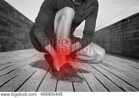 Fitness Runner With Ankle Pain Or Achilles Injury. Ankle Twist Sprain Accident. Running Or Workout I