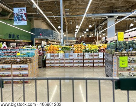 The Produce Aisle With A Cart Point Of View Of A Whole Foods Market