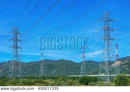 High Voltage Electric Towers On The Background Of Nature. Mountain Landscape. Vietnam