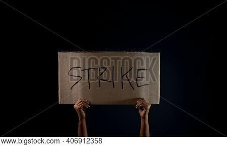 Protest , Strike, Mob Or Expression Concept. Person Raised A Corrugated Paper With Text. Front View
