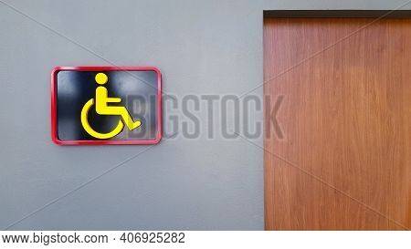 Toilet Sign On Gray Or Grey Wall For Reserved Disable People Use This Washroom Only With Copy Space.