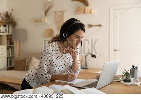 Young Woman In Headphones Study Online On Laptop