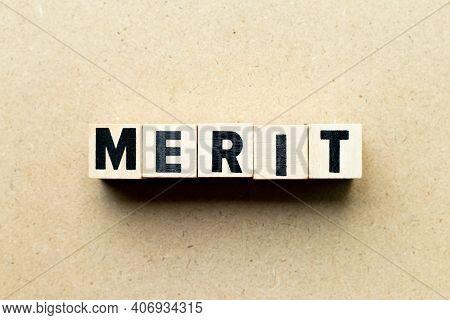 Alphabet Letter Block In Word Merit On Wood Background