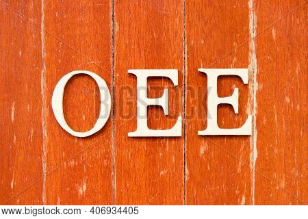 Alphabet Letter In Word Oee (abbreviation Of Overall Equipment Effectiveness) On Old Red Color Wood