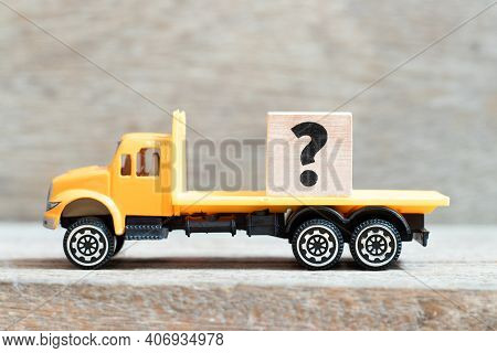 Toy Truck Hold Alphabet Letter Block Question Mark On Wood Background