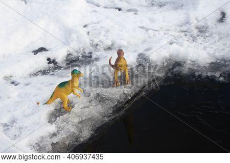 A Tyrannosaurus Dinosaur And A Pachycephalosaurus Stand On Ice Next To Water Ice Age