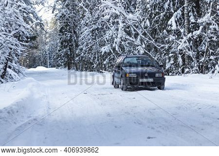 Minsk. Belarus. 06 February 2021. A Retro Blue Car Is Parked In The Snow. Bad Weather