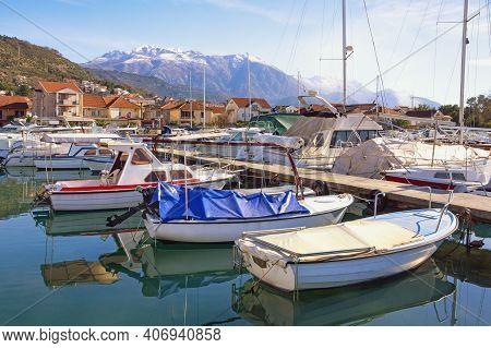 Fishing Boats In Harbor. Beautiful Winter Mediterranean Landscape. Montenegro. View Of Marina Kalima