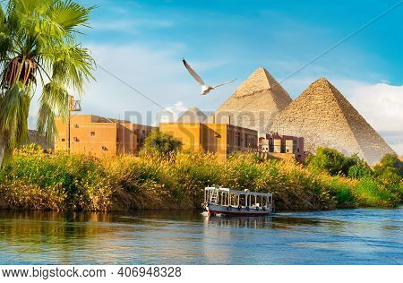 Pyramids Near The Nile River At Sunset
