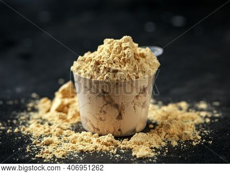 Scoop Of Pea Vegan Protein Powder On Dark Rustic Background. Sport Nutrition.