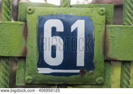 Weathered Grunge Square Metal Enameled Plate Of Number Of Street Address With Number 61