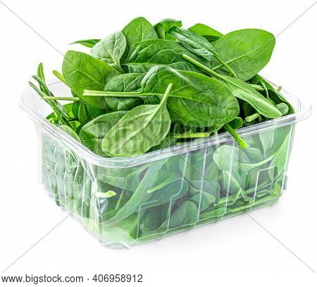 Spinach Leaves  In A Plastic Package Isolated On White Background. Green Spinach Leaf Box Side View.