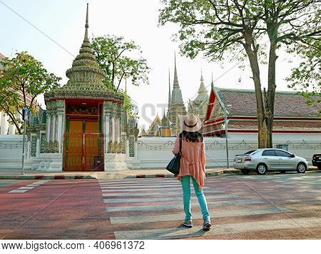 Woman Walking On The Crosswalk Leading To The Gorgeous Gate Of Wat Pho Or Temple Of The Reclining Bu