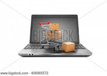 Ideas about online shopping, Cartons boxes in a shopping cart on a laptop keyboard on white background, including clipping path